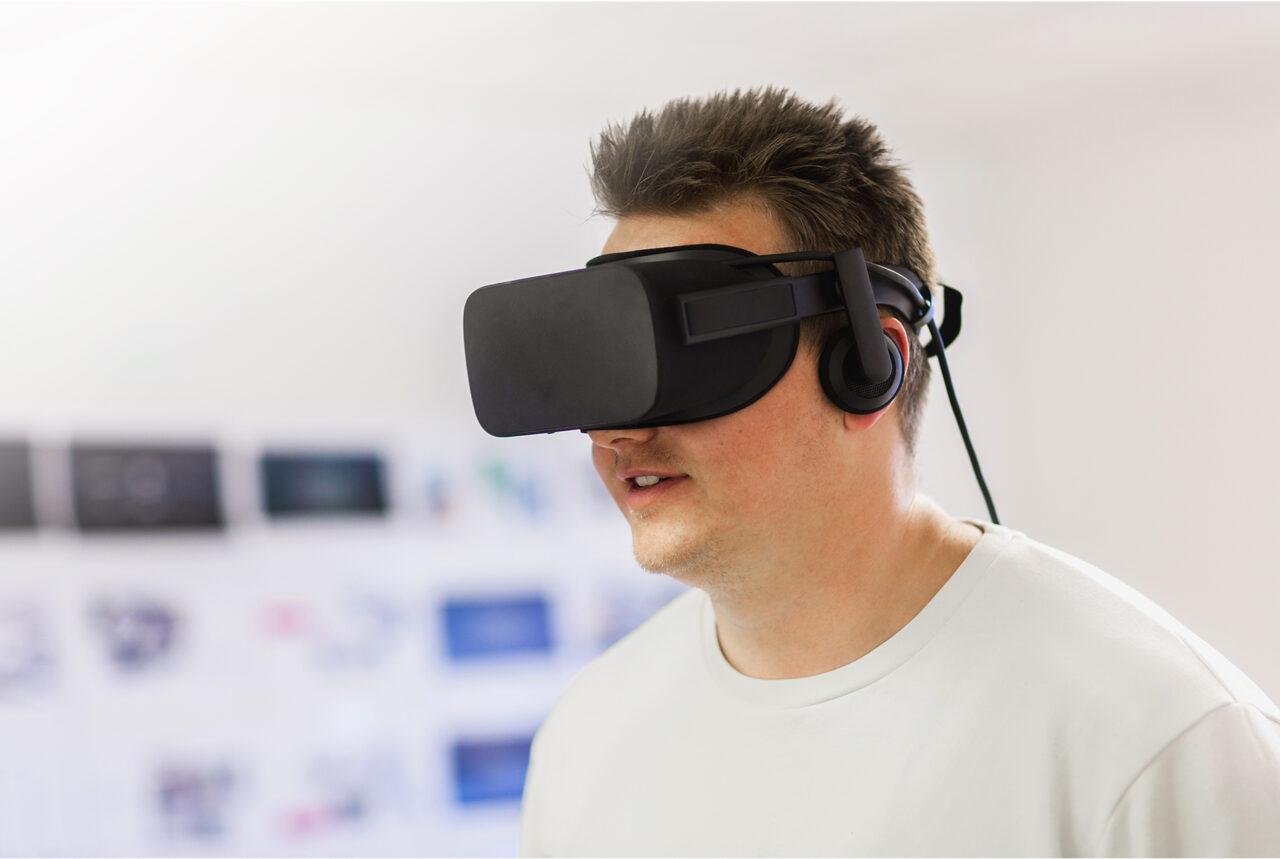 Adam Sidaway wearing a VR headset