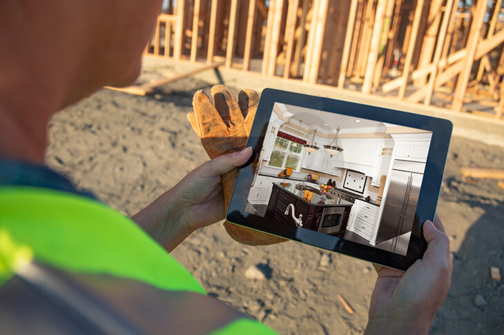 Construction worker holding iPad